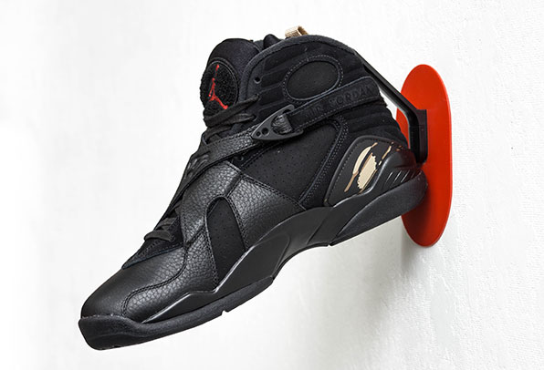 Staeckler shoe hook holding an Air Jordan on the wall